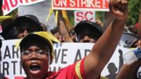 Fast food workers and activists demonstrate outside the McDonald's corporate campus in Oak Brook, Illinois