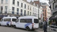 Police vans are parked around the scene of a shooting near the Jewish Museum in Brussels