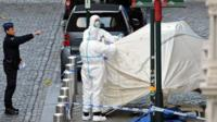 Police personnel are seen at the site of a shooting in central Brussels May 24, 2014