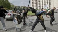 Masked pro-Russian militants smash up ballot boxes in Donetsk (25 May)