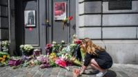 People laid flowers outside the museum as a mark of solidarity and respect