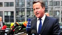 David Cameron talks to reporters