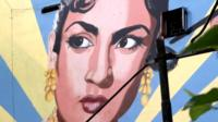 Picture of a woman painted on the walls of Delhi