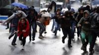People run away from teargas