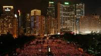 Tens of thousands of people holding candles in Victoria Park, Hong Kong