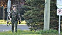 A heavily armed man identified as Justin Bourque walked in Moncton, New Brunswick, on 4 June 2014
