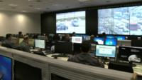 Computer monitors inside a security centre in Brazil