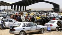 Families fleeing Mosul arrive at a checkpoint in outskirts of Arbil