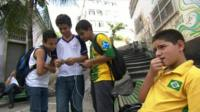 Brazilian football fans looking at football cards