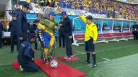 Man in robotic suit kicks-off World Cup