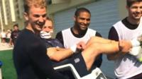 England's Joe Hart, Glen Johnson and Steven Gerrard carry Paul Small
