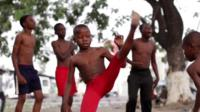A child dancing at a capoeira class