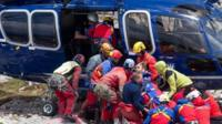 Johann Westhauser is carried to a helicopter by rescue workers
