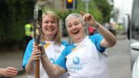 A woman holds the baton on Day 2 of the Queen's Baton Relay in Scotland
