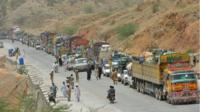 A line of vehicles as Pakistani civilians, fleeing a military operation in North Waziristan