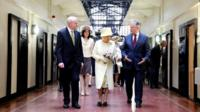 Queen with Peter Robinson (R) and Martin McGuinness