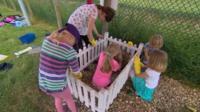 Children cleaning Dusty's gravestone