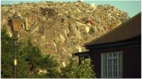Rubbish mound behind property