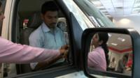 Customers in a car showroom