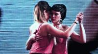 Same-sex couple dancing tango