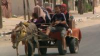 People on a donkey cart
