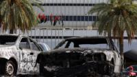 Burnt vehicles in the compound of Tripoli international airport