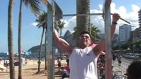 Raymond from Canada works out on the beach in Rio.