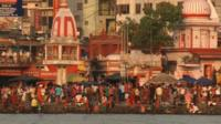 Pilgrims gather on the banks of the River Ganges in Rishikesh
