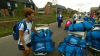 Athletes move into the Athletes' Village