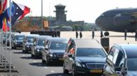 Hearses carry coffins containing unidentified bodies from the crash of Malaysia Airlines flight MH17