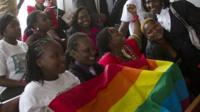 Gay community and rights activists smile in court