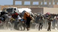 Egyptian fleeing Libya at Tunisia border corssing