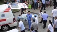 Man injured in Kunshan factory explosion being put into ambulance
