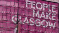 Building with slogan 'People make Glasgow'