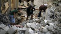 Palestinians search for the remains of bodies under rubble