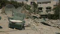 Armchair amidst the ruins of a house in Gaza