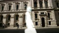 Graphic of ghostly figure in front of Whitehall buildings
