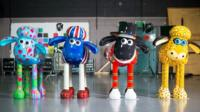 Four customised Shaun sculptures