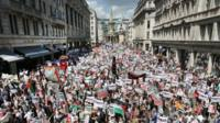 Protestors march down Regent Street