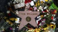 Flowers surround Robin Williams' star on the Hollywood Walk of Fame