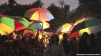Supporters of Imran Khan listen to his speech during a protest in Islamabad, Pakistan