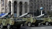 Soldiers salute during Ukraine's Independence Day military parade