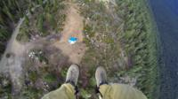 Smokejumper's view as he parachutes into the wilderness