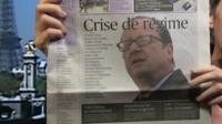 Lucy Williamson holding Le Figaro newspaper