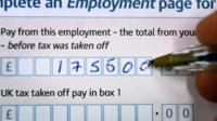 A tax return form being filled in