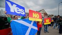Yes and No campaigners wait for the departure of Labour leader Ed Miliband on the Scottish independence campaign trail on September 4, 2014 in Blantyre, Scotland