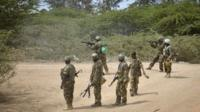 African Union (AU) soldiers from Uganda fire at al-Shabab positions in the Lower Shabelle region of Somalia on 30 August 2014