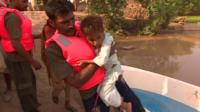 Rescue worker carrying child