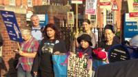 Protestors outside Hammersmith Hospital