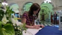 Lord Mayor of Belfast Nicola Mallon signs the book of condolence